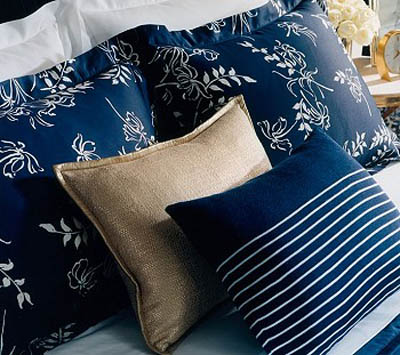 striped and floral pillows in white and blue colors