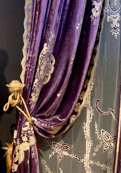 purple draperies with golden and embroidered details