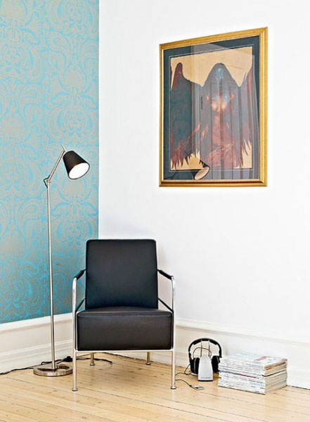 modern chair in black and floor lamp