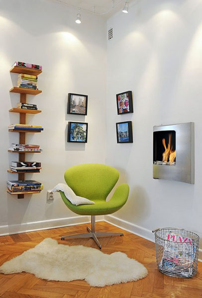 green chair with wooden shelves and wall fireplace