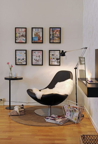 contemporary chair, small table ad floor lamp
