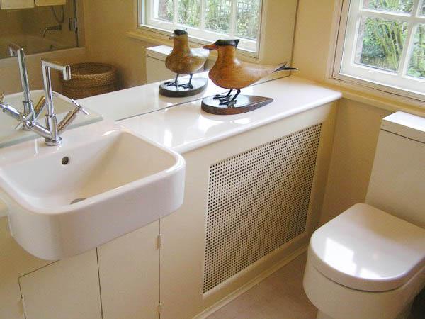 bathroom heater cover with a shelf