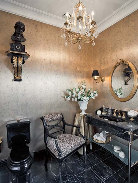 dressing table and chair in bathroom with round wall mirror
