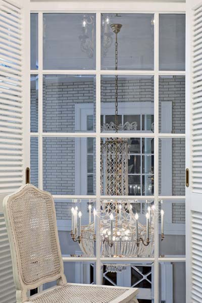crystal chandelier and white furniture