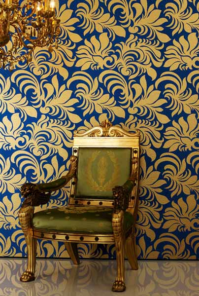 blue wallpaper with golden floral designs
