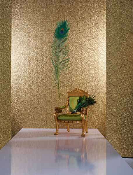 golden wallpaper with peacock feather