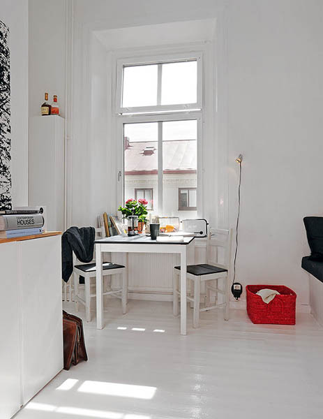 black and white decorating with red accents