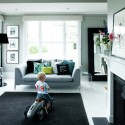 black floor carpet, mirror and picture frames