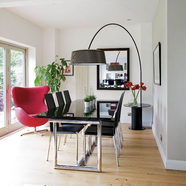 red chair in black ad white room, dining room decorating