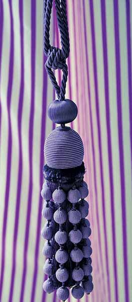 white and purple striped curtains and purple tassels