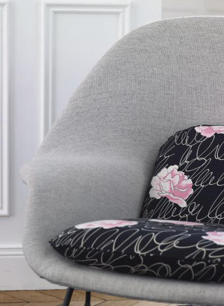 black upholstery fabric with white graphic print and pink floral designs