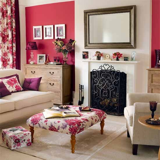 pink wall and white fireplace with rectangular wall mirror