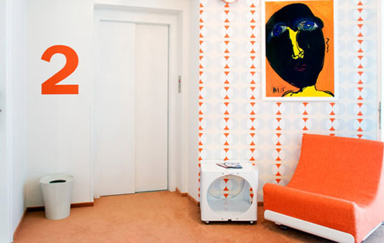 retro chair and walpaper in orange colors