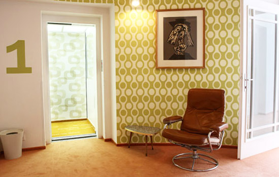 retro wallpaper patterna and brown chair