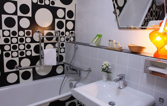 retro bathroom with black-n-white wall tiles