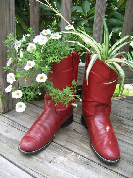 red boots with plants and flowers