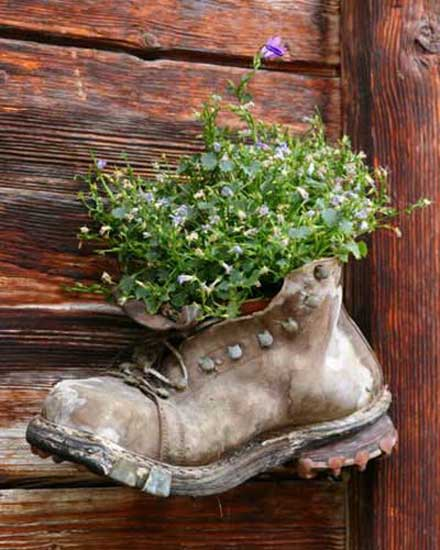 hanging boot container with plants