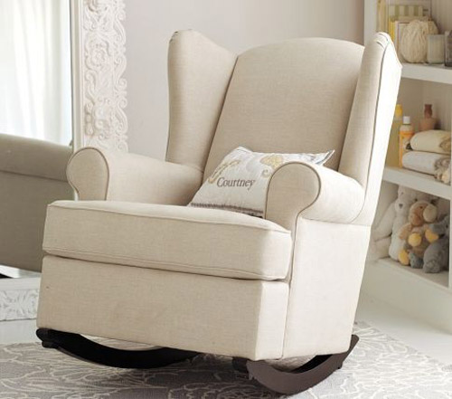 white upholstered chair with pillow