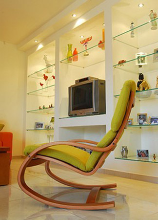 contemporary chair design with green pad