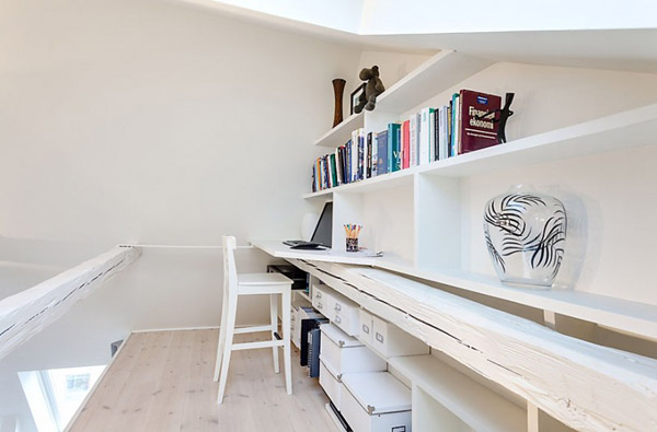white home office with shelves