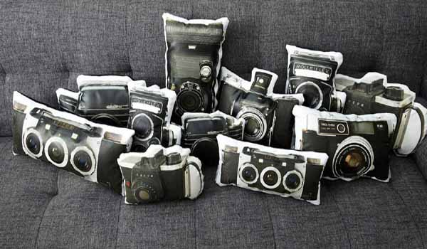 black and white pillows with old camera prints