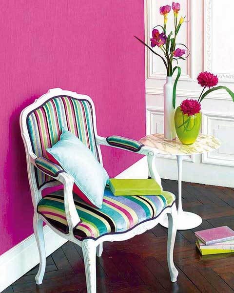 white chair with striped colorful upholstery fabric