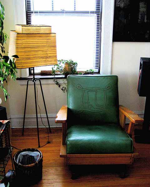 green chair and retro floor lamp