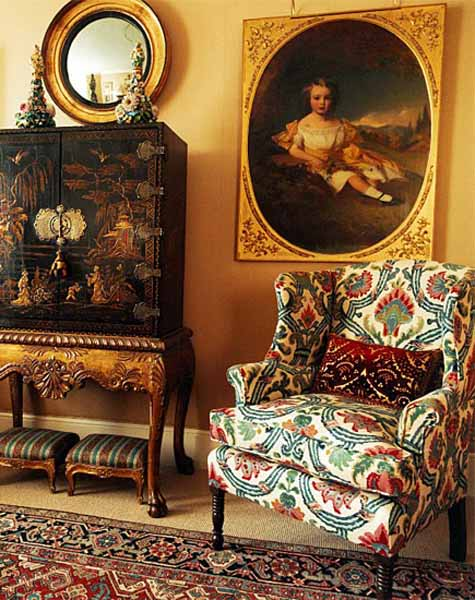 colorful upholstered chair and vintage furniture for interior decorating