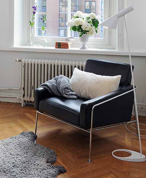 black leather chair with metal frame in retro style