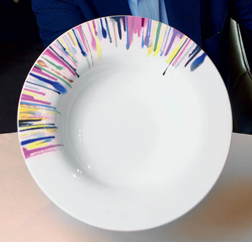 white plate with colorful stripes