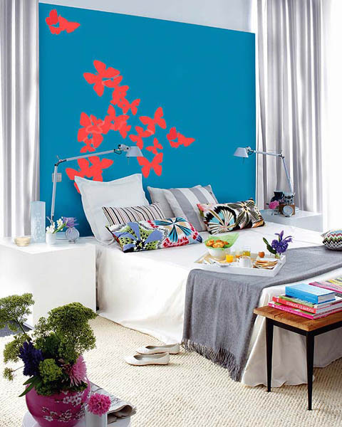 blue wall paint with red and gray bedroom decor accessories