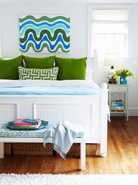 blue wall decor with green pillows