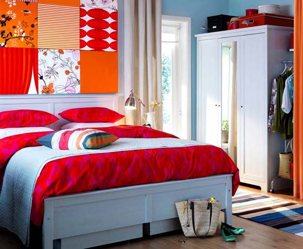 blue wall paint and bedding with red and orange wall decor