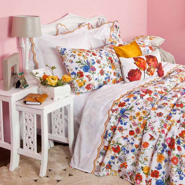 white bedding set and floral designs