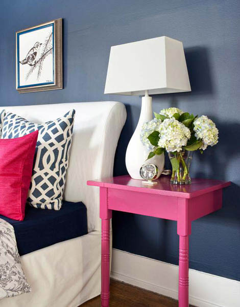 pink bedside table, blue wall paint and white bedroom decor