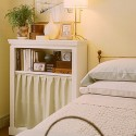 bedside cabinet in white color with curtain