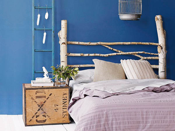 contemporary bedside table, blue wall paint, white bedding