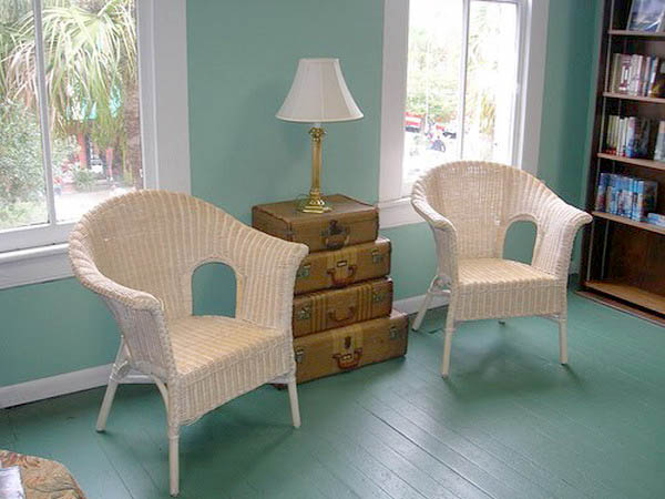 two chairs with side table made of old suitcases