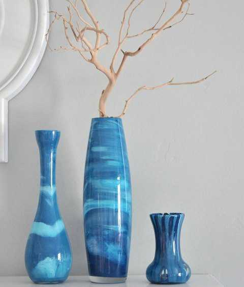 blue decorative vases with dry branches