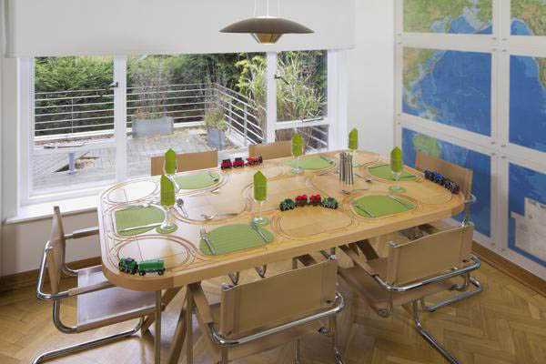 dining furniture with trains transporting food around table