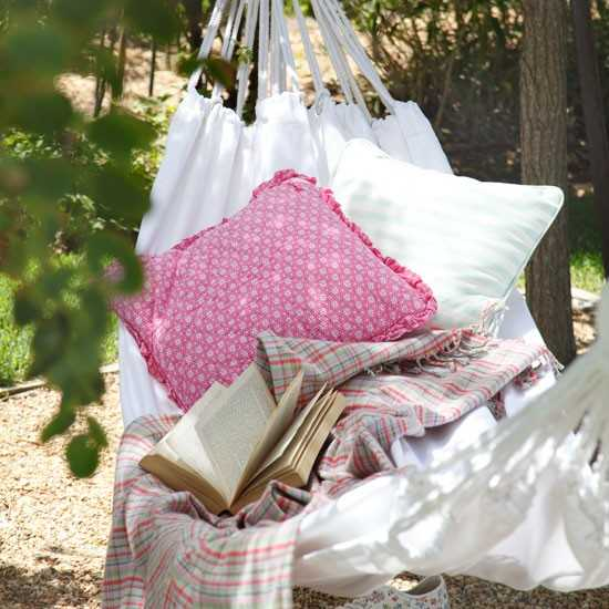 hammock with white and pink pillows