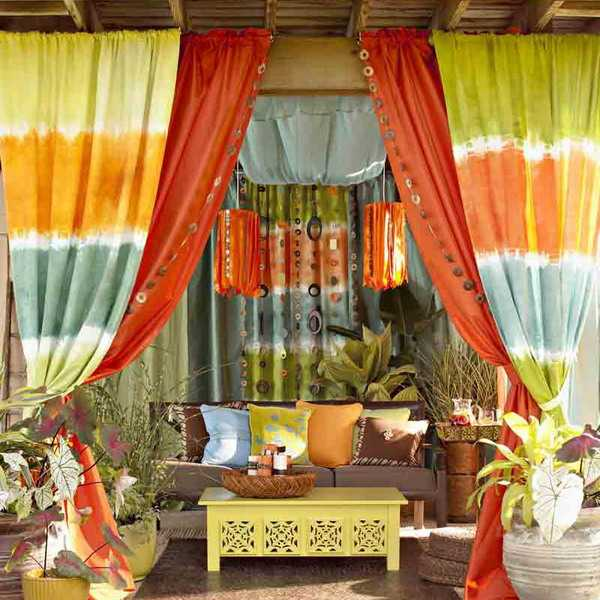 striped and orange curtains and colorful decorative pillows