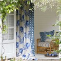 white and blue curtains and decorative pillows
