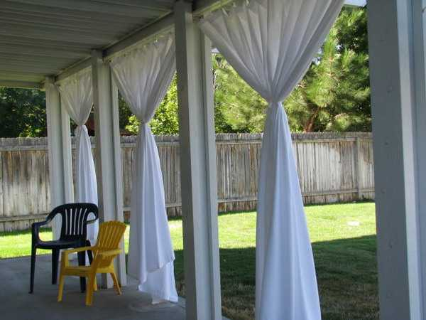 White Curtains And Roofed Patio Design