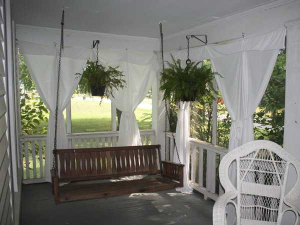 Great White Curtains And Hanging Bench For Porch Decorating