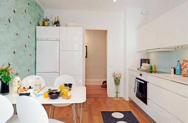 white kitchen cabinets and dining furniture