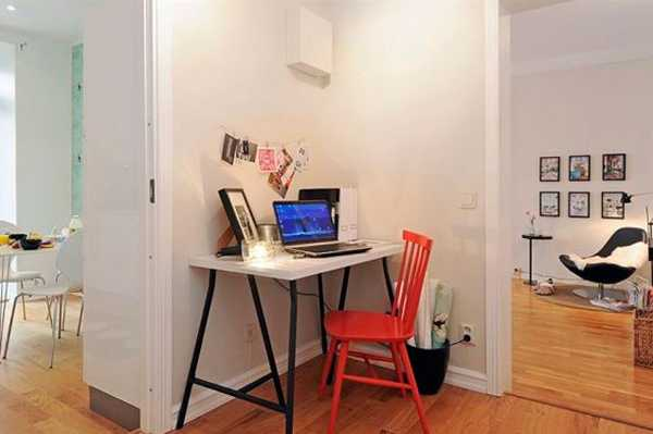 small home office desk and red chair