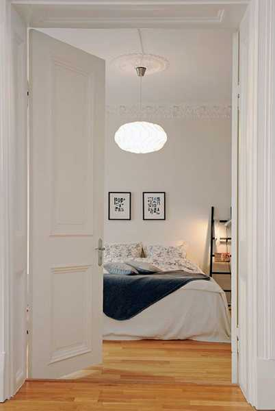 white bedding and lighting fixture