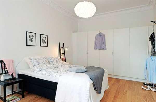 white storage furniture and walls