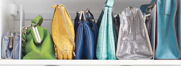 Shelf With Space Dividers For Bags Storage